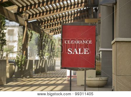 Clearance sale sign outside shop in outdoor upscale shopping mall