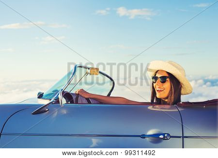 Happy Young Woman Driving in Classic Vintage Sports Car