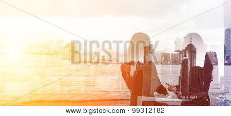Silhouette of two businesswomen stand and look far away in Hong Kong, Asia. Double exposure.