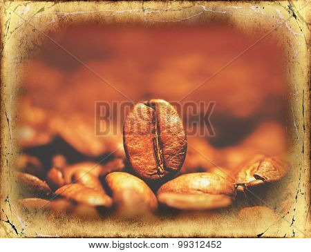 Closeup of coffee beans with focus on one.Filtered image: vintage effect.