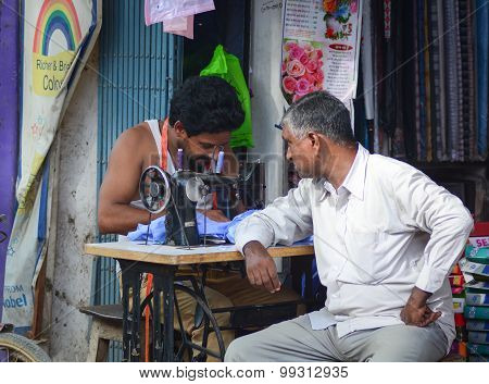 Portrait Of Indian Man Tailor At Work Place