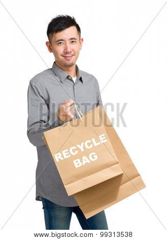 Asian man hold with shopping bag and showing recycle bag