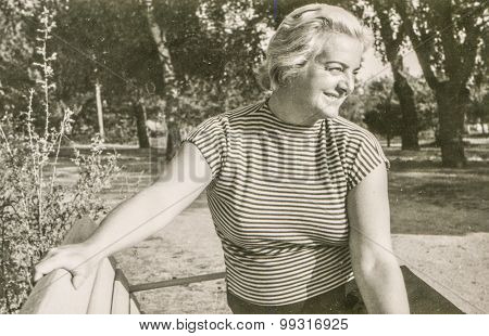 Vintage photo of woman on bench, 1950's