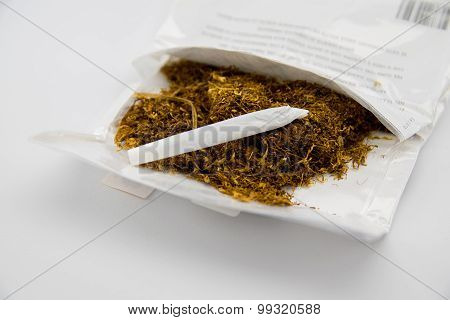 Package Of Tobacco And Hand Made Cigarette