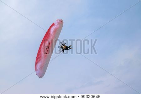 Motorized Paraglider Flying In The Blue Sky