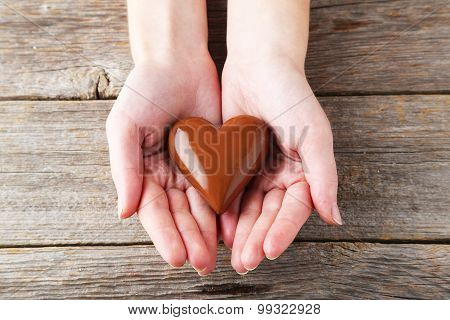 Woman's Hands With Chocolate Heart