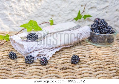 Blackberries and vintage spoon background.