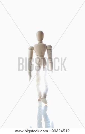 Wood Puppet Going Into The Light On White Background