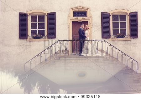 Bridal Couple On Stairs Of Their House