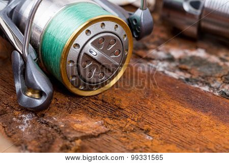 Fishing Reel With Line On Background