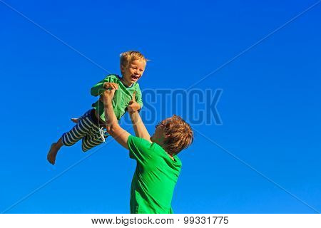 father and son having fun on sky