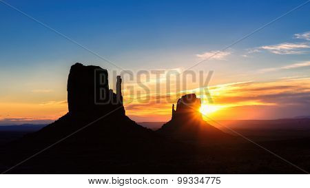 Shilouette of Monument Valley at sunrise, Arizona