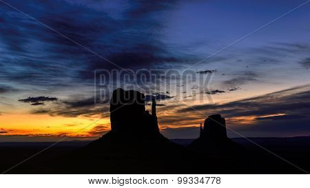 Shilouette of Monument Valley at sunrise