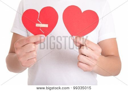 Man Holding Broken Heart With Plaster And Normal Paper Heart