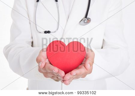 Health Care Concept - Doctor Holding Red Heart Isolated On White