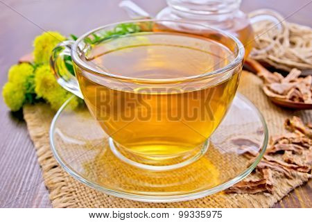 Tea of Rhodiola rosea in glass cup on board