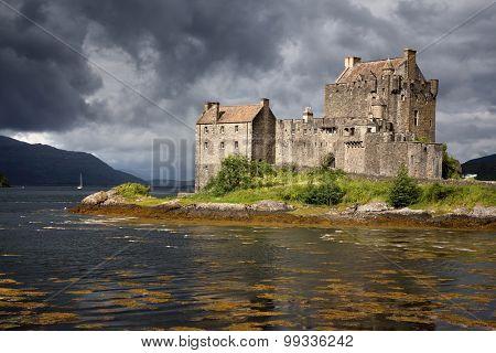 A storm brews over Eilean Donan Castle, Scottish Highlands, Scotland, UK
