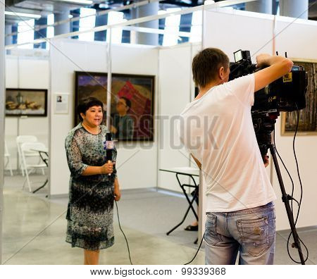Female Television Broadcaster At Work