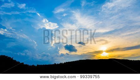 Silhouette Shot Image Of Mountain And Sunset Sky  In Background