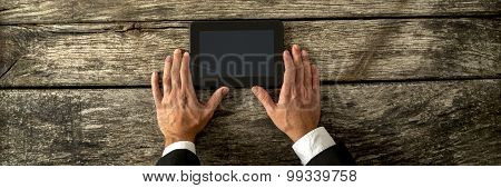 Top View Of Businessman Hands Holding Black Digital Tablet