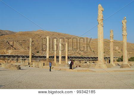 People make travel photo at the ruins of Persepolis in Shiraz, Iran.