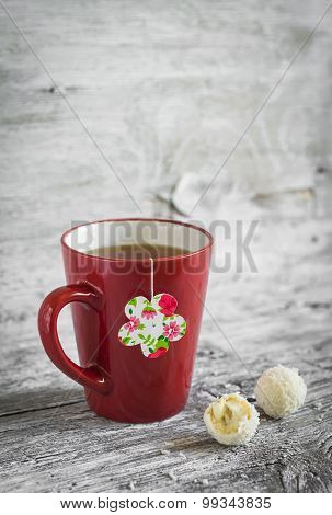 Tea In A Red Cup And A Homemade Tea Bag On A Light Wooden Background, Vintage Style