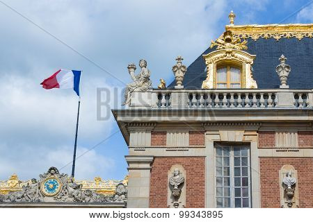 Roof Details With Flag Of Palace Versailles Near Paris, France