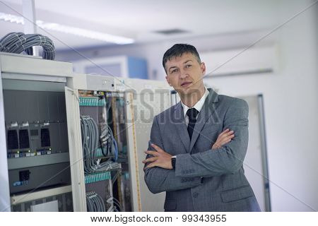 network engineer working in  server room, corporate business man