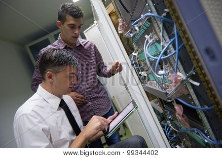 business people group working on tablet computer, network engineers in server room
