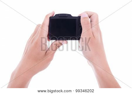 Hands Holding Digital Camera With Blank Screen Isolated On White