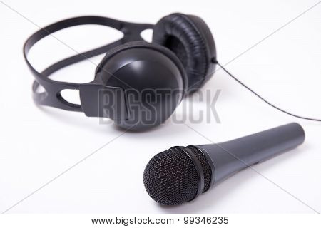 Music And Sound Concept - Close Up Of Microphone And Headphones Over White