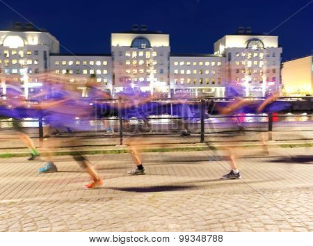 Group Of Runners In Blue Dresses, Motion Blur