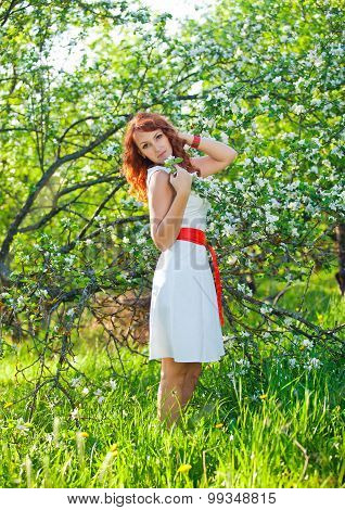 Free Happy Woman with Gorgeous Red Hair Enjoying Nature