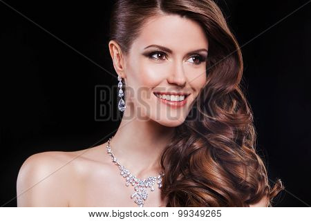 portrait of a beautiful brunette girl with luxury accessories. fashion model
