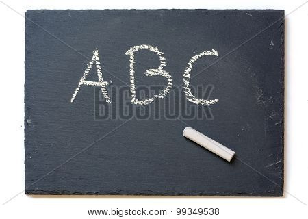 Chalkboard With Chalk And The Letters A, B, C, Isolated On White