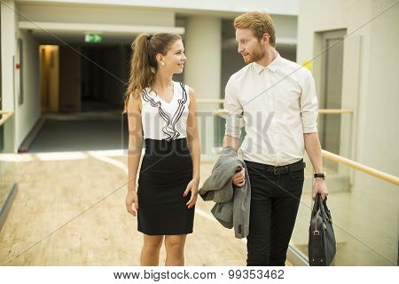 Young Business Couple In The Hallway