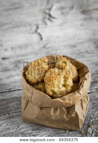 Oatmeal Cookies With Apples In A Paper Bag On A Light Wooden Background