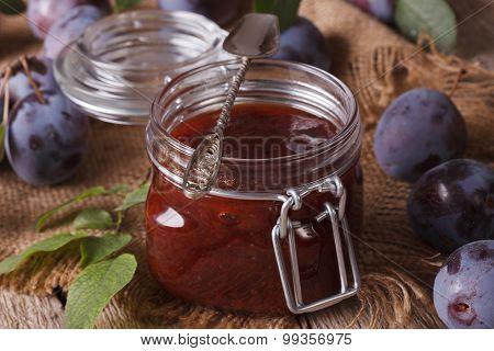 Fresh Homemade Plum Confiture In A Glass Jar Close-up. Horizontal