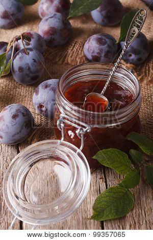 Fresh Homemade Plum Jam In A Jar On The Table Close-up. Vertical