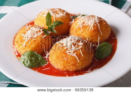 Delicious Rice Balls In Tomato Sauce On A Plate Close-up. Horizontal