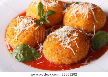 Italian Rice Balls In Tomato Sauce On A Plate Close-up. Horizontal