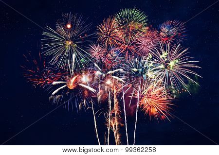 Fireworks at night over dark blue sky