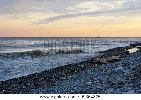 Sea waves on beach in the evening