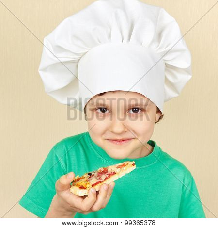 Little funny chef is going to try cooked pizza