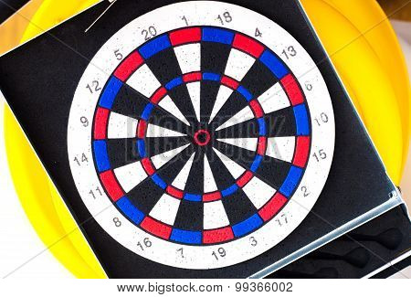 Dart board on a yellow background