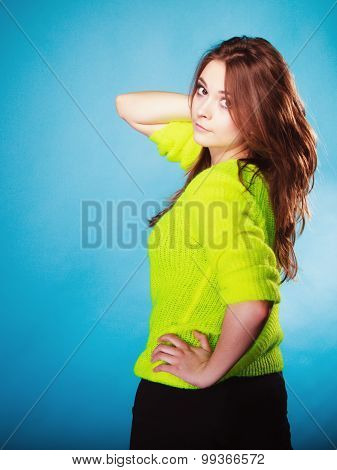 Portrait Teen Girl In Vivid Colour Sweater On Blue
