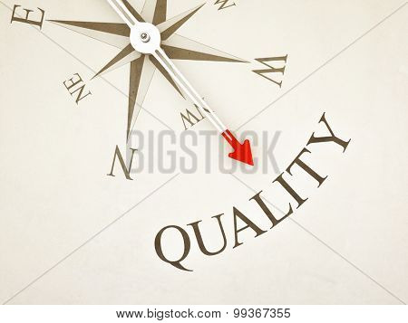 An image of a nice compass with the word quality