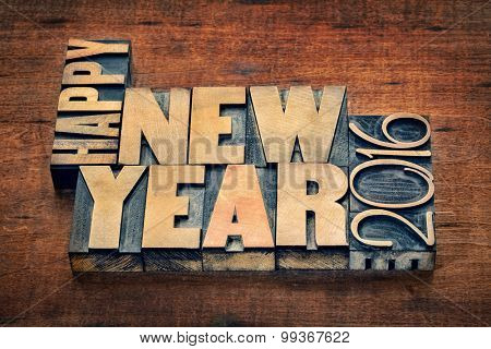 Happy New Year 2016 greetings  - text in grunge letterpress wood type blocks on a rustic wooden background