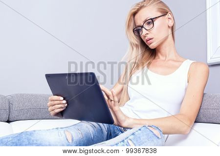 Young Beautiful Girl Using Tablet.