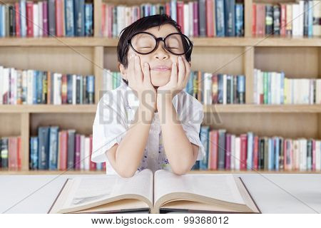 Cute Student With Glasses Daydreaming In Library